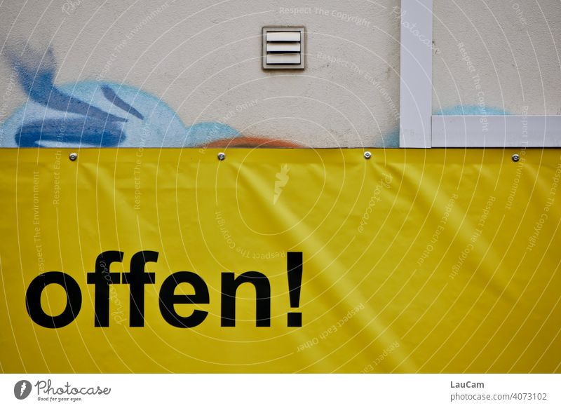 """Black lettering """"open!"""" on a yellow plastic tarp with graffiti writing Letters (alphabet) Open Wall (building) Yellow yellow-black house wall Facade Word"""