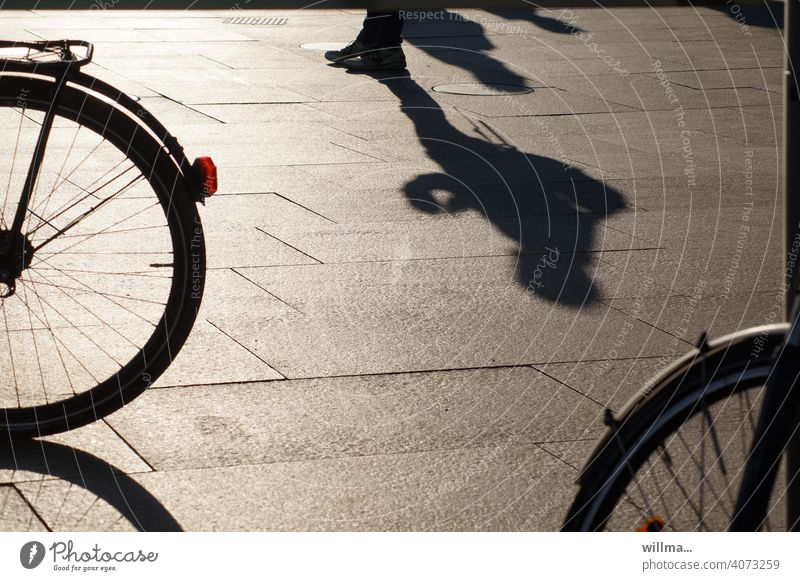 waiting for the date Wait Human being Shadow Stand Bicycle Places Pedestrian precinct urban Shadow play on one's own Individual