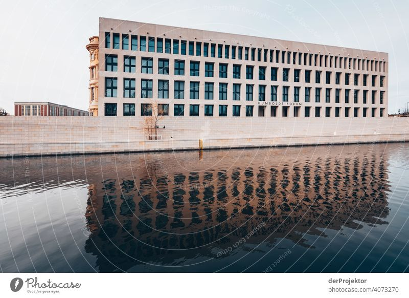 Humboldtforum in the Berlin City Palace with reflection in the river Spree Blue sky Historic Buildings Downtown Tourist Attraction Copy Space right
