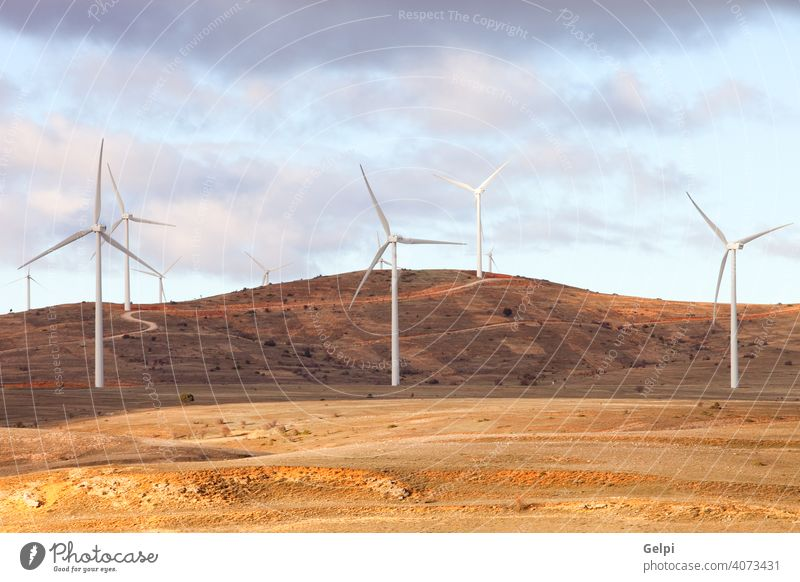 Landscape with wind park windmill wind-turbine energy environment renewable sunny alternative blue climate conservation development ecology efficiency electric