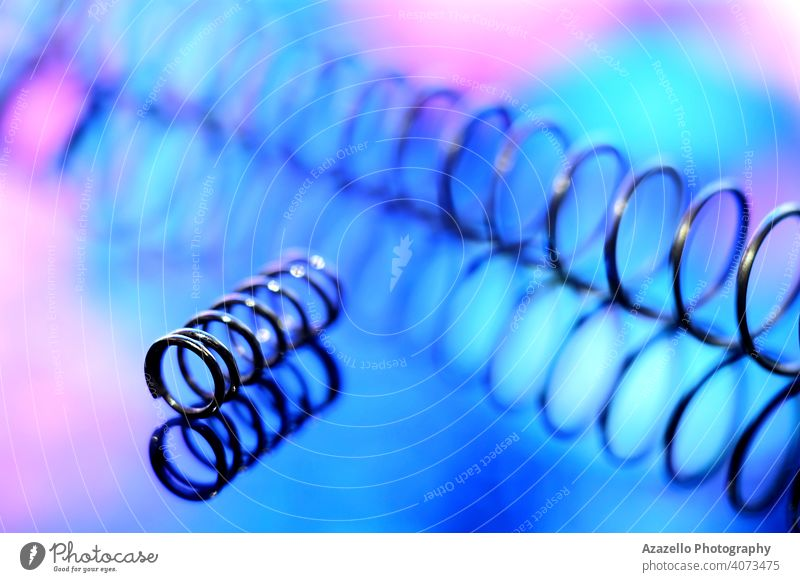 Iron spirals in blur. Shiny metal springs in blur. abstract art blue blurry closeup coiled color composition concentrate create creativity defocused design dna