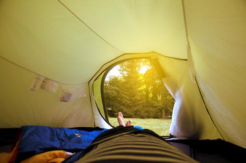 garden holidays Lifestyle Leisure and hobbies Human being Masculine Man Adults Legs Feet 1 Lie Tent Camping Camping site Entrance Way out Sleeping bag