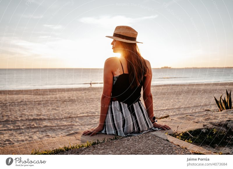 Young woman with hat on the beach on vacation in southern spain nature summer ocean sea sky sunny young happiness natural wireless leisure activity portrait