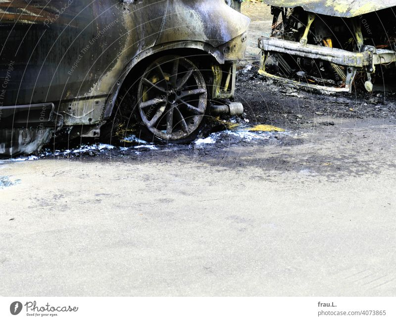 Burnt out Wrecked car Water for firefighting Town Roadside Total loss Fire Transport Street Car