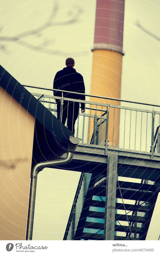 smoking break Human being person Stand rail Rear view Stairs Chimney slanting tilted worldview Man iron stairs looking to the future Climate change ponder