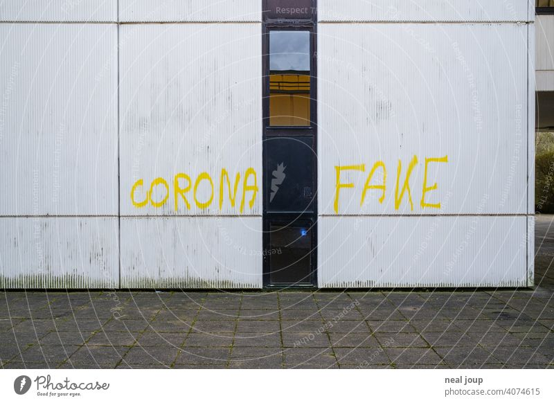 Yellow graffiti - Corona theme - on a white wall Crisis corona COVID Anger Opinion Comment pandemic Graffiti saying writing Handwriting Virus Healthy