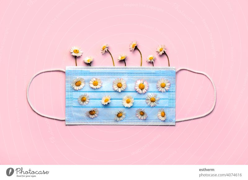 Protective surgical mask with white daisy flowers.Concept of an spring allergy coronavirus protective surgical mask medical face masks medical mask 2019-ncov