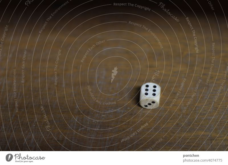 a dice with six eyes. gambling, social game, throwing dice cubes Game of chance Compulsive gambling Throw dice Playing Crap game Leisure and hobbies