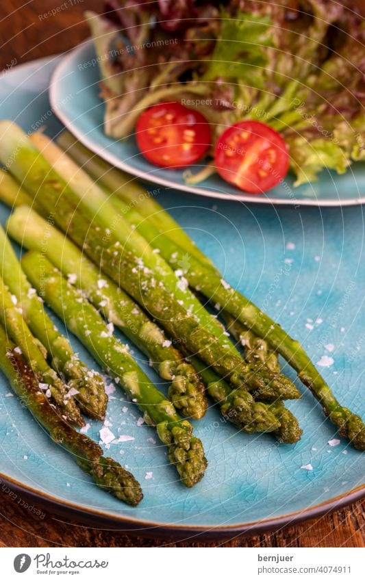 grilled green asparagus on a blue plate Asparagus plank Wood Holiday season seasonal Gourmet string Kitchen Ingredients Asparagus spear Food handle freshness