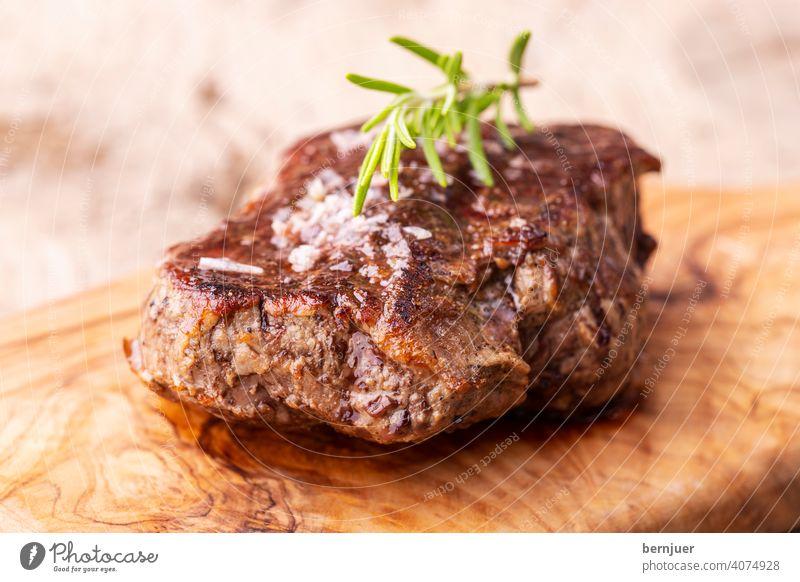 grilled juicy steak on olive wood Steak Meat Beef Rosemary barbecue Black tenderloin rib sirloin Meal BBQ Eating board Knives beef steak Slice chopping board
