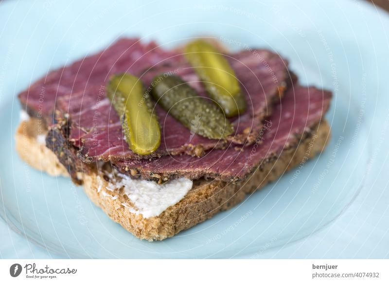 Pastrami on rye toast Close-up Mustard Bread Delicious Culinary Jewish Pepper homemade pastami Table Horizontal deli red meat Beef Contentment rye bread