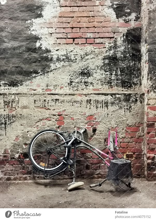 Lost - the pink girl's bike has found its final resting place in an old abandoned hall. lost places Architecture Derelict Ravages of time Apocalyptic sentiment