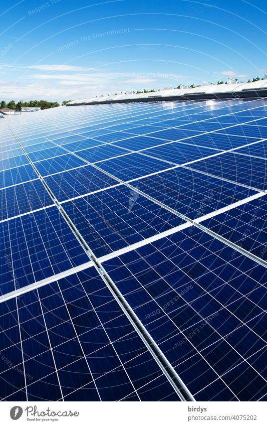 An area of many photovoltaic panels. Solar power plant on an industrial roof , many solar panels , photovoltaics Solar Power Solar Energy photovoltaic system