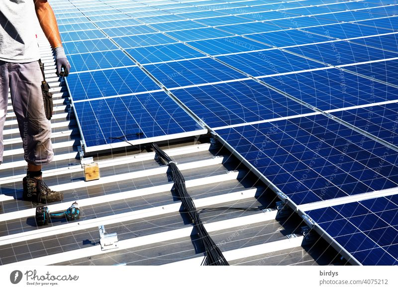 Installation of a photovoltaic system on a factory roof, PV system, solar technology Montage Roof mounting Factory roof photovoltaics Solar Power Solar Energy