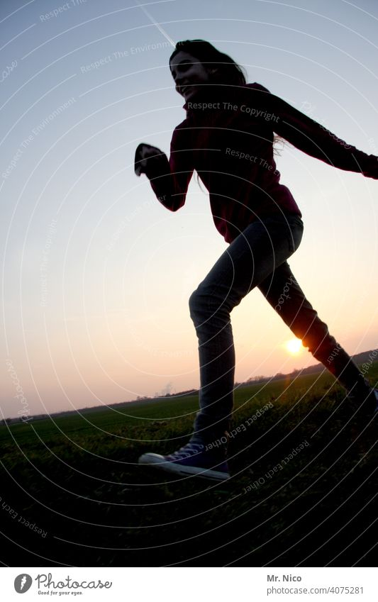 jauntily Walking Silhouette Girl Sunset Shadow Landscape Twilight Sky Chucks Posture Running Back-light Worm's-eye view Athlete fit Fitness Movement Athletic