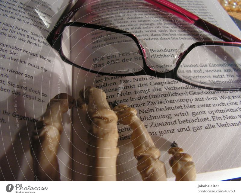 senior studies Literature Reading Reading glasses Book Leisure and hobbies hand of the dead Closed text passage