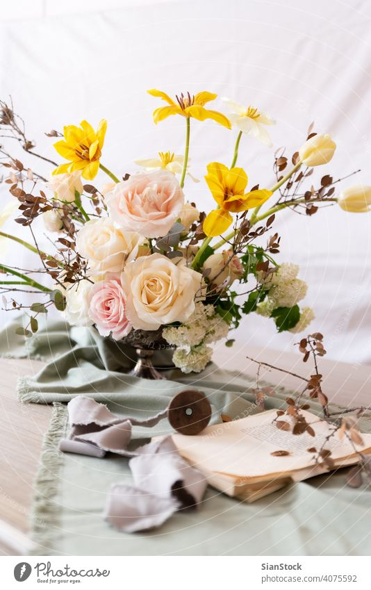 Still life with a beautiful bouquet of flowers table vase wedding decoration white book books background interior arrangement dinner romantic pink rose design