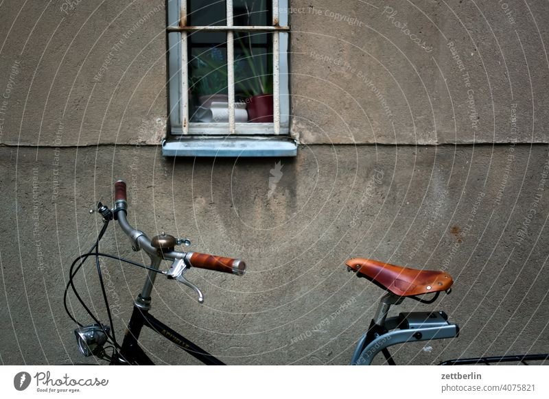 Bicycle in the backyard Old building on the outside Fire wall Facade Window House (Residential Structure) rear building Backyard Courtyard Interior courtyard