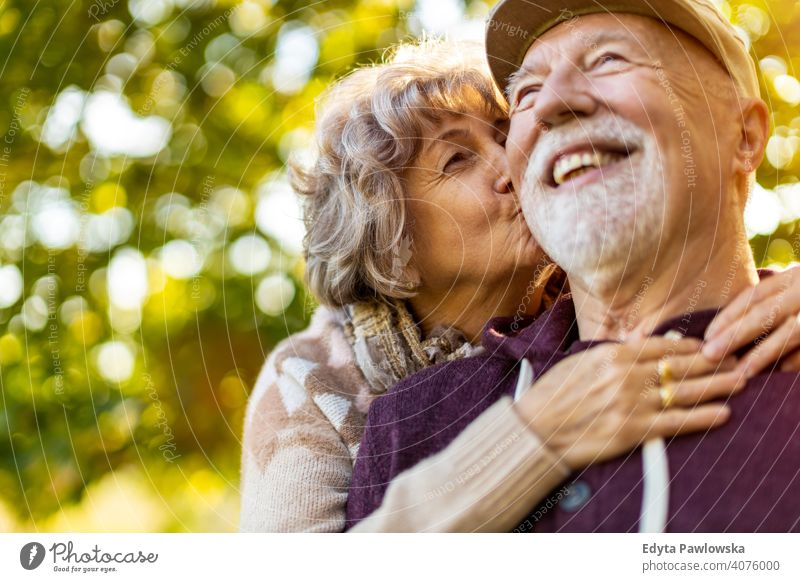 Senior couple enjoying autumn colors together senior love real people retired pensioner retirement aged grandmother grandparent grandfather day two togetherness