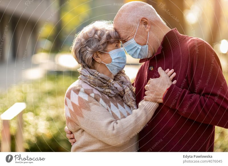 Senior couple wearing protective face masks outdoors senior love real people retired pensioner retirement aged grandmother grandparent grandfather day two