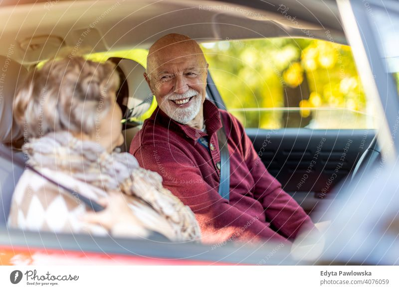Happy Senior Couple travelling in their car vehicle driver driving journey trip road transport auto senior couple love real people retired pensioner retirement