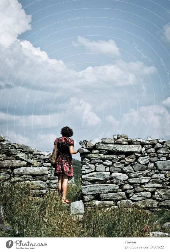 Human being Woman Youth (Young adults) Old Loneliness Calm Young woman House (Residential Structure) Adults Wall (building) Warmth Feminine Wall (barrier) Stone