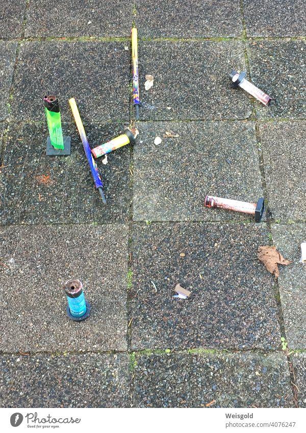 Remains of fireworks, New Year's Day Firecracker firecrackers Town Trash New Year's Eve Exterior shot Blaze Colour photo Environment Environmental pollution