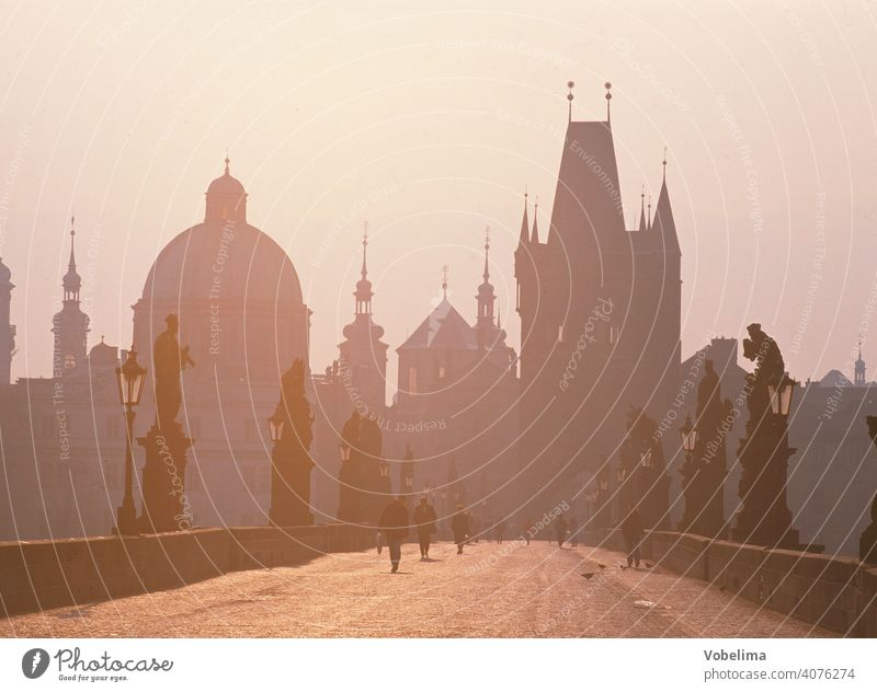 Charles Bridge in Prague off Czech Republic Europe Old town Tower spires Architecture Morning in the morning Haze morning sun