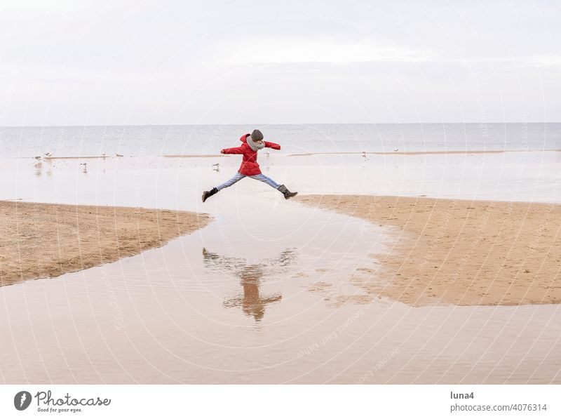 young girl jumping at the booth Girl Jump joyful leap Child Beach Skip Baltic Sea free time vacation holidays Autumn fortunate Joie de vivre (Vitality) cheerful