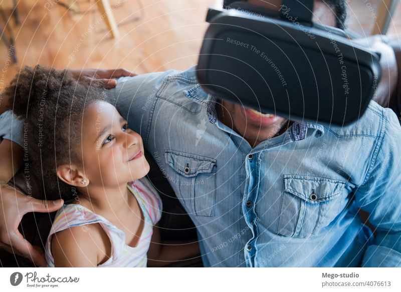 Father and daughter playing video games. monoparental vr entertainment together device digital headset father relax equipment joy internet stay home indoor