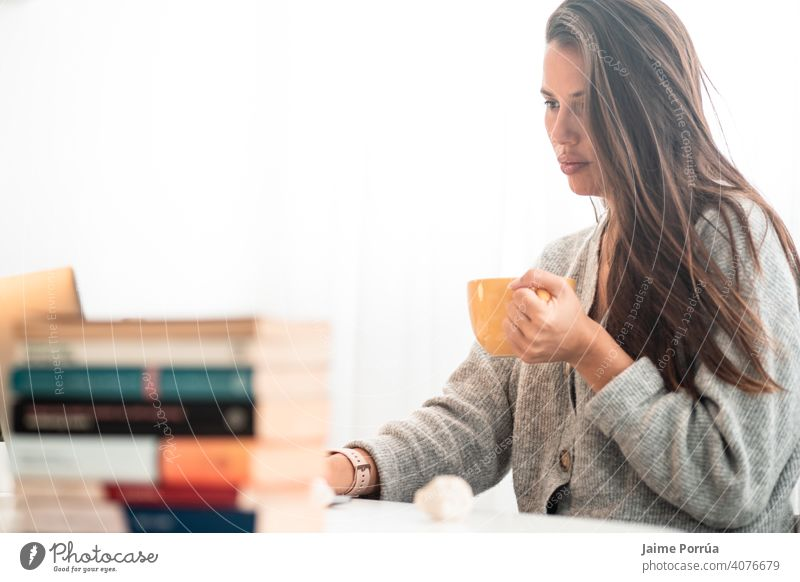 young woman teleworking at home with computer drinking coffee spectacles service one person call communication female businesswoman beautiful european people