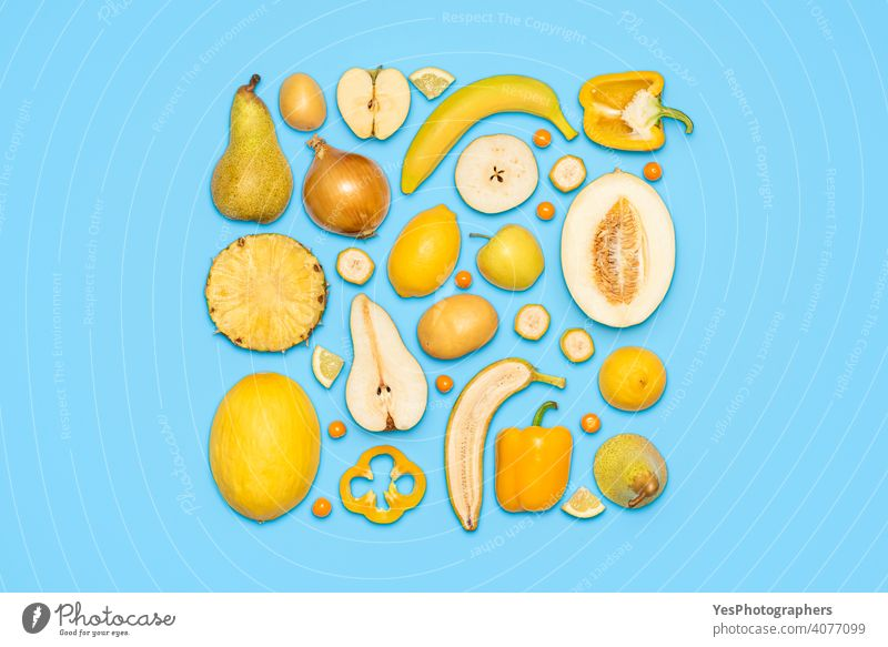 Yellow fruits and vegetables top view on blue background. above view apple banana citrus colorful colors copy space creative cut out detox diet diversity