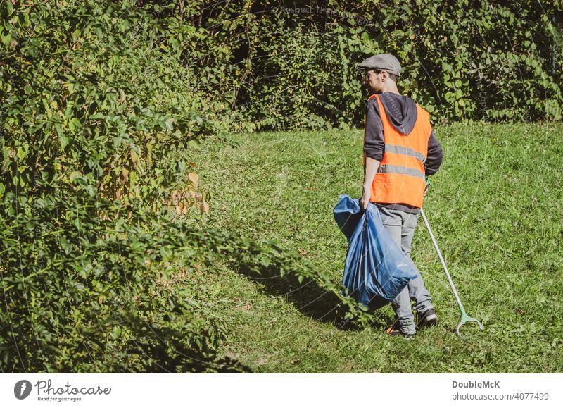 A man searches for trash in nature on World Cleanup Day clean up Action day social action Environment Trash September civic movement Eliminate removal