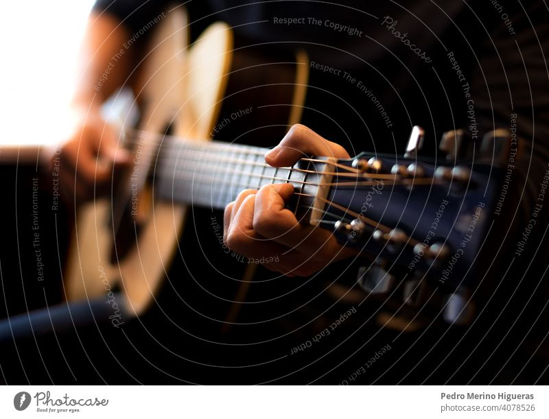 man playing acoustic guitar. Close-up music musician musical guitarist male sound instrument rock song player person performer performance young hand blues