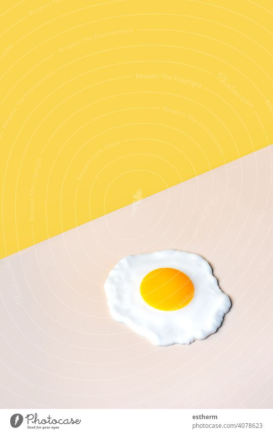 fried egg on a beige background eggs food chicken eggs easter eggs yolk fresh egg yolk eat cooking cholesterol farming farmyard animal egg freshness agriculture