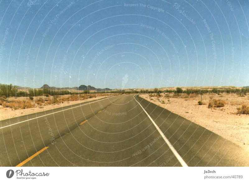 Open Road Far-off places Long Desert USA Central perspective Empty Deserted Blue sky Sky blue Cloudless sky Clear sky Horizon Right ahead Lane markings