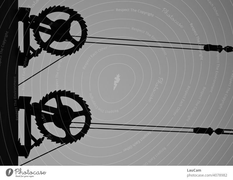 Cogwheels and overhead line of the Berlin tram Gearwheel Gears Overhead contact lines Overhead line stream Tram Abstract Technology Machinery Metal Mechanics