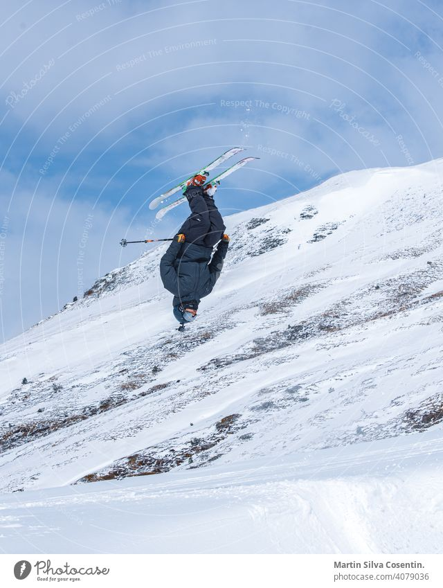 Young  man skiing on a sunny day in Andorra. action active alps andorra arcalis athlete background cold colour competition deep snow downhill editorial extreme