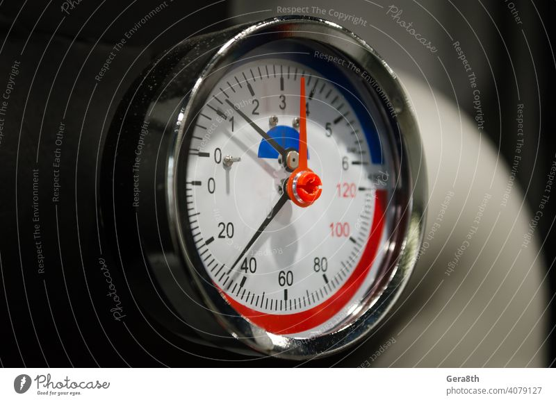 measuring pressure instrument manometer close up abstract arrow background black brown circle closeup control dashboard data design detail element engineering