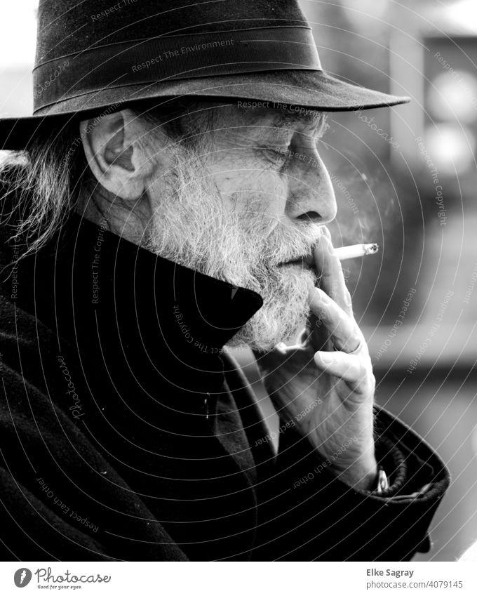 Elderly Gentleman Thoughtfully Smoking... Man Only one man Exterior shot Surface of water Black & white photo smartphone Shallow depth of field Senior citizen