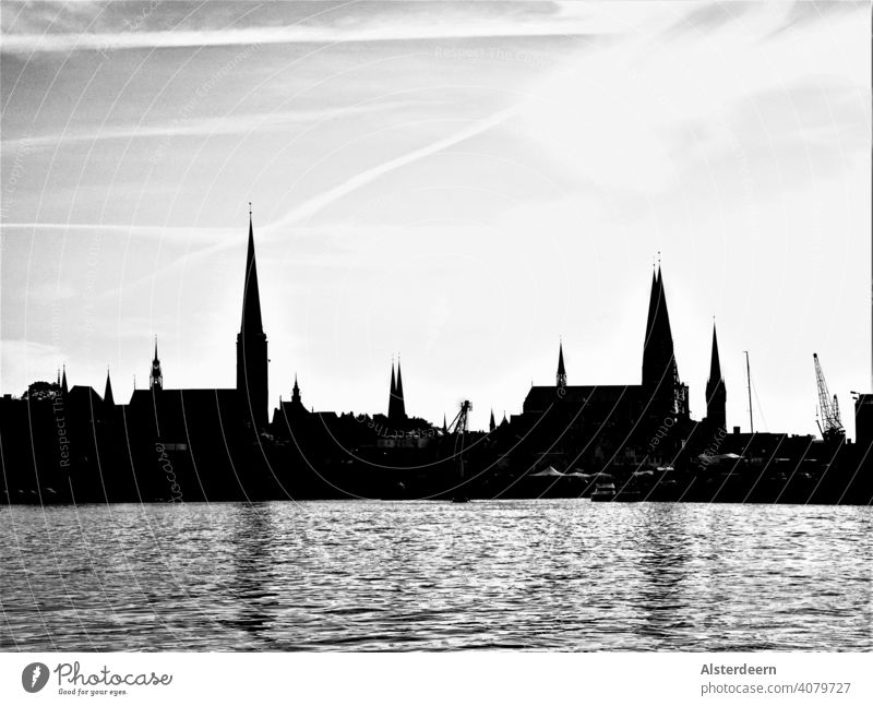 Skyline of Lübeck view from the north to the old town with the seven church towers in black and white city Lübeck view from north View old town Harbour