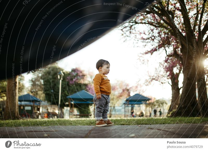 Child  standing in the playground Boy (child) 1 - 3 years Caucasian Playground Curiosity colorful Spring Spring colours Nature Authentic Exterior shot