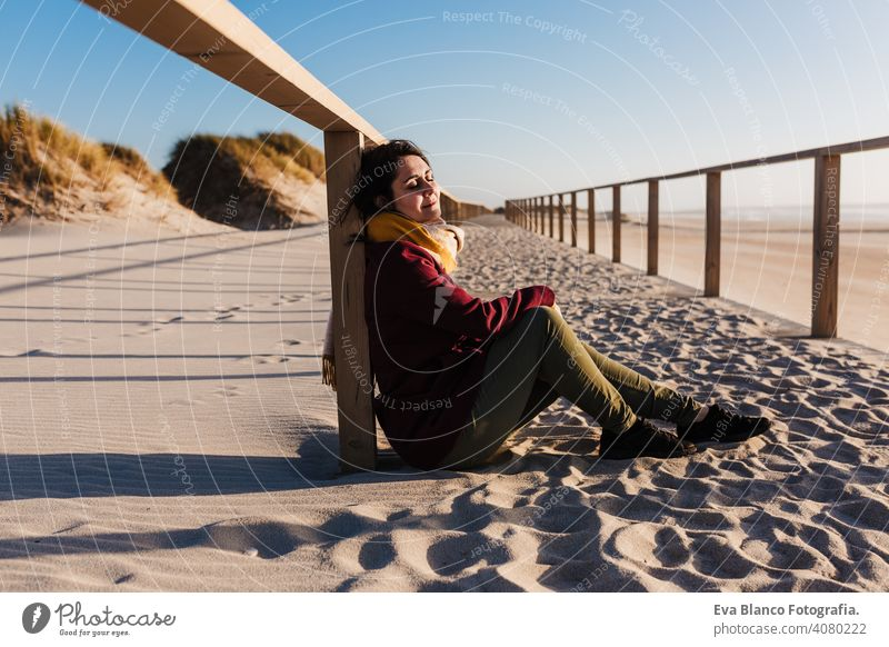 young caucasian woman with eyes closed relaxing at the beach at sunset. Holidays and relaxation concept vacation holidays runway passage attractive pretty