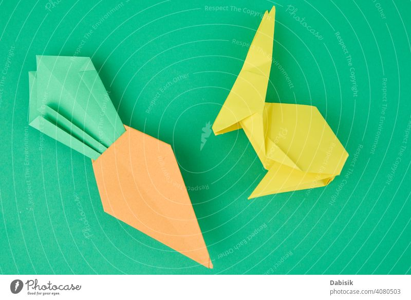 Paper origami rabbit and carrot on green background bunny holiday animal decoration spring happy paper cute celebration art easter colorful handicraft design