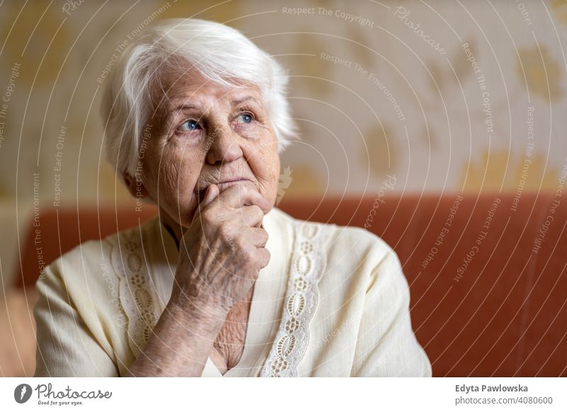 Senior woman lost in thought people senior mature casual female Caucasian elderly home house old aging domestic life grandmother pensioner grandparent retired