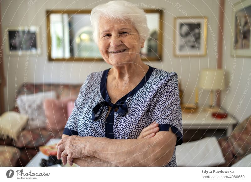 Portrait of an elderly woman at home smiling happy enjoying positivity vitality confidence people senior mature casual female Caucasian house old aging