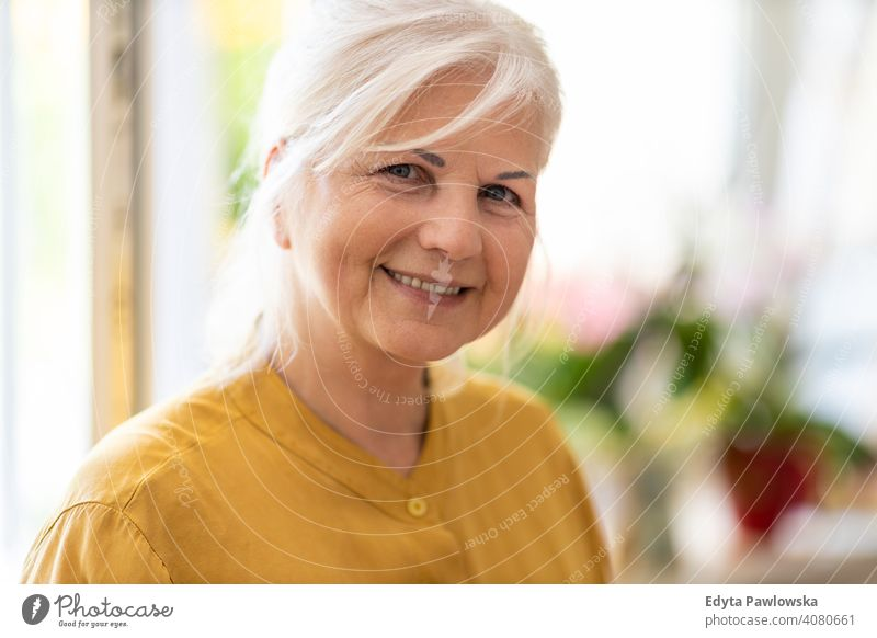 Portrait of an mature woman at home smiling happy enjoying positivity vitality confidence people senior casual female Caucasian elderly house old aging