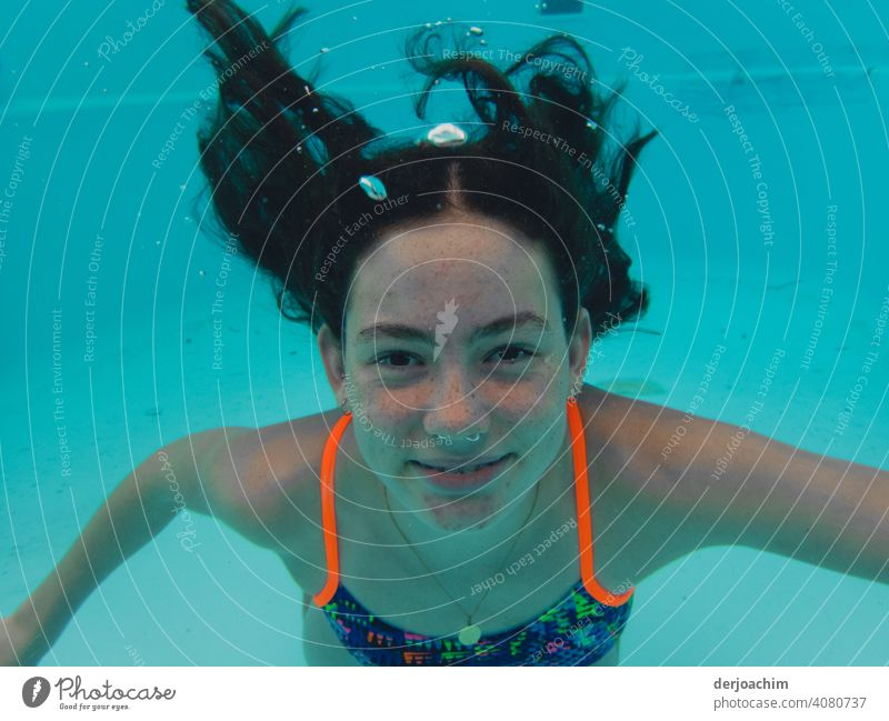 Blub, blub . Laughing young girl with long black hair under water. Water Blue Relaxation Sky Summer Sun Nature Beautiful weather Colour photo Day
