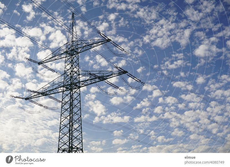 Overhead Power Pole with High Voltage Lines against a Blue Sky with Sheep Clouds / Power Pole / Energy Electricity pylon Overhead line mast power line