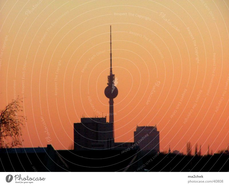 Television tower in the firestorm Vantage point Photographic technology Berlin TV Tower Dusk alex forum hotel